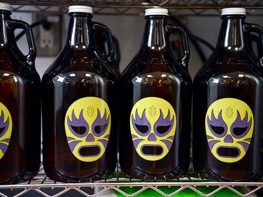 AVL Tacos and Taps features drive-thru growlers of craft beer to go.