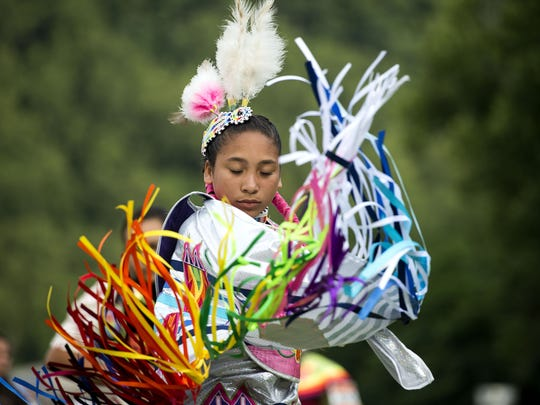 A young Native American woman twirls and dances during the grand entry Saturday July 1, 2016 at the start of the 41st annual 4th of July powwow in Cherokee.