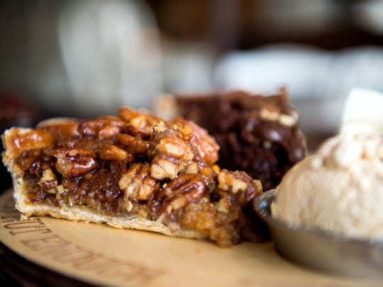 A slice of honey pecan is one of the many homemade pies offered at Baked Pie Company, located on Long Shoals Road.
