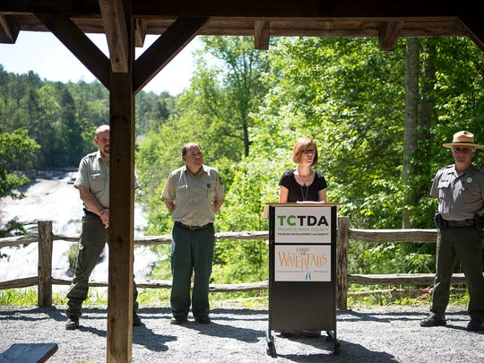 Lori Roberts, chair of the Transylvania Tourism Development Authority, speaks about waterfall safety in front of High Falls in DuPont State Forest Friday June 2.