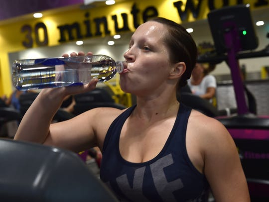Rebecca Lauber rehydrates while walking/running on