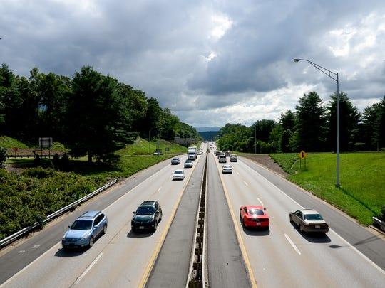 Traffic makes  its way down Interstate 240 in West Asheville near the Brevard Road overpass in this 2016 photo.