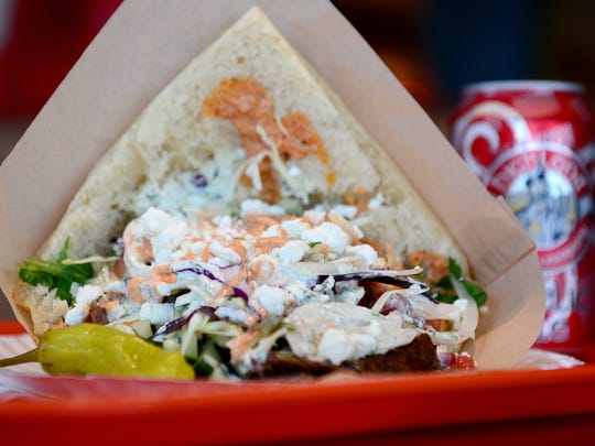 The Doner Kebab is made with beef and lamb on kebab bread and topped with lettuce, cabbage, cucumber, tomato, white and red onion, herb yogurt sauce, spicy mayo sauce and goat cheese at The Doner Kebabs & Falafels at the Asheville Mall.