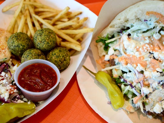 The falafel box and a beef and lamb sandwich are two offerings at The Doner Kebabs & Falafels inside the Asheville Mall. Diners can choose to have their protein in a wrap, on kebab bread, in a box with fries, or on a salad.