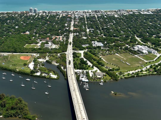 The Merrill P. Barber Bridge (foreground, seen Monday, April 4, 2016) goes over the Indian River Lagoon in Vero Beach to Beachland Boulevard (center), which heads to the Atlantic Ocean.