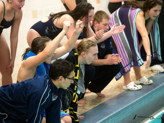 The South Western swim team cheers on swimmers, Thursday, Jan. 4, 2018. The South Western Mustangs beat the New Oxford Colonials, 121-59 for the boys; 104-79 for the girls.