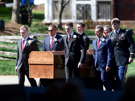Pallbearers carry Billy Graham's casket into the funeral