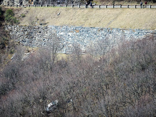 A white sedan sits on the side of an embankment about 250 feet off the Blue Ridge Parkway near the Craggy Gardens Visitor Center on Tuesday, April 3, 2018. A 25-year-old man drove the car off the parkway in a suspected suicide just after 8 p.m. Monday.