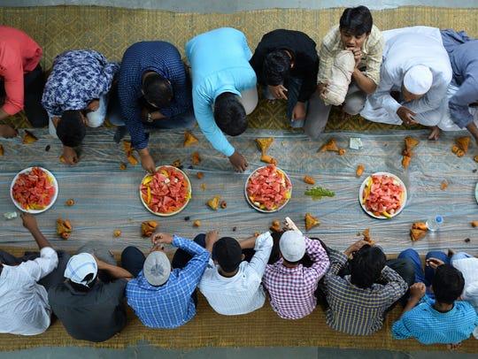 Indian Muslim devotees break their Ramadan fast with
