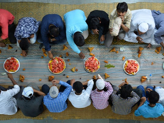 Indian Muslim devotees break their Ramadan fast with 'iftar' in Bangalore in this 2016 file photo.