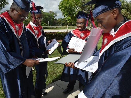 St. Lucie West Centennial graduates (from left) Travon
