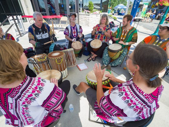 Drum circle members perform in Fishers during last year's festival.
