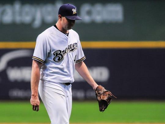 Brewers closer Corey Knebel hangs his head as he walks
