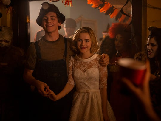 Ross Lynch as Harvey and Kiernan Shipka as Sabrina