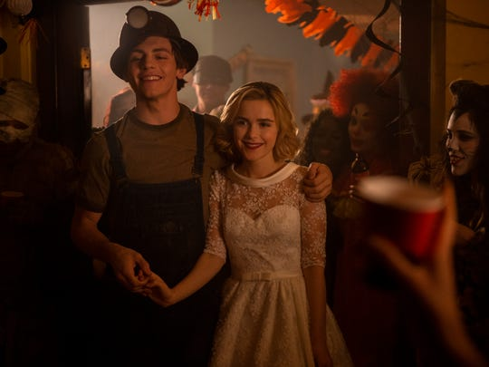 "Ross Lynch as Harvey and Kiernan Shipka as Sabrina on ""Chilling Adventures of Sabrina."""