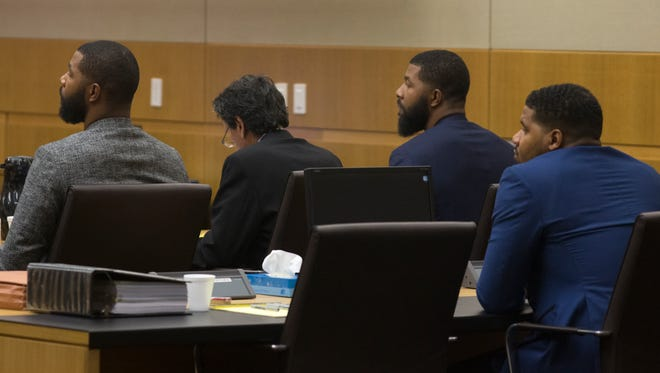 Marcus Morris (from left), attorney James Belanger, Markieff Morris and Gerald Bowman sit Sept. 18, 2017, in Maricopa County Superior Court in Phoenix.