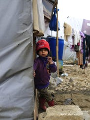 In this picture taken Monday, a Syrian refugee boy