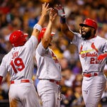 PITTSBURGH, PA - SEPTEMBER 30: Jason Heyward #22 of the St Louis Cardinals is congratulated at home plate by teammate Jon Jay #19 after hitting a grand slam home run in the third inning against the Pittsburgh Pirates during the game at PNC Park on September 30, 2015 in Pittsburgh, Pennsylvania. (Photo by Jared Wickerham/Getty Images)
