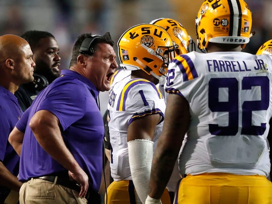 LSU head coach Ed Orgeron talks to his team during a timeout in the second half of an NCAA college football game against Alabama in Baton Rouge, La., Saturday, Nov. 3, 2018. Alabama won 29-0. (AP Photo/Gerald Herbert)