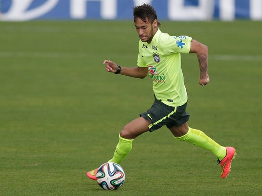 Brazil's Neymar practices during a training session of Brazil at the Granja Comary training center in Teresopolis, Brazil, Monday, June 9, 2014. Brazil play in group A of the 2014 soccer World Cup. (AP Photo/Andre Penner)