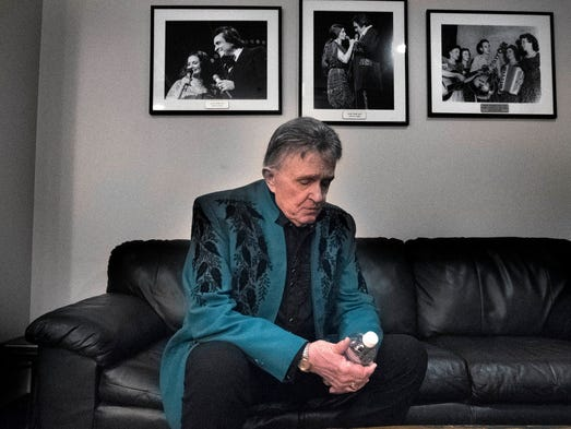 Bill Anderson sits in his dressing room after his set