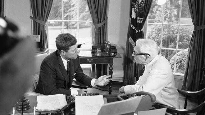 President John Kennedy confers with Bernard Baruch, 90-year-old New York financier, at the White House in Washington on July 26, 1961. They talk in the President's office.