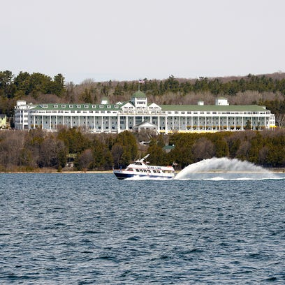 The Star Line ferry zooms past the Grand Hotel on Lake