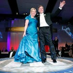 Bob McDonnell waves to the crowd along with his wife, Maureen during his inaugural ball in Richmond in 2010.