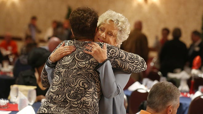 """Heart transplant recipient Elizabeth Coughlin, Brighton, right, hugs Liz Powley, N.P., Transplant Coordinator, during the UR Medicine's 200 Hearts 200 Second Chances celebration of Strong Memorial's 200th heart transplant held Oct. 22, 2016 in Rochester.  Coughlin, transplant No. 160, received her heart Feb. 28, 2013.  """"I would not be here without this,"""" she said.  """"I'm forever grateful to everyone."""""""