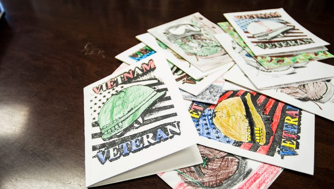 Cards from Centerville-Abington Elementary School students to veterans of the Vietnam War are seen on a table inside Centerville Public Library on Wednesday, March 28, 2018.