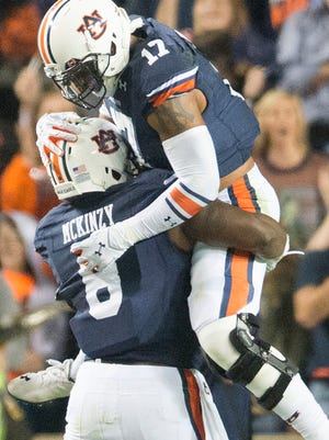 Auburn linebacker Cassanova McKinzy celebrates after intercepting the ball during Saturday's game with South Carolina.