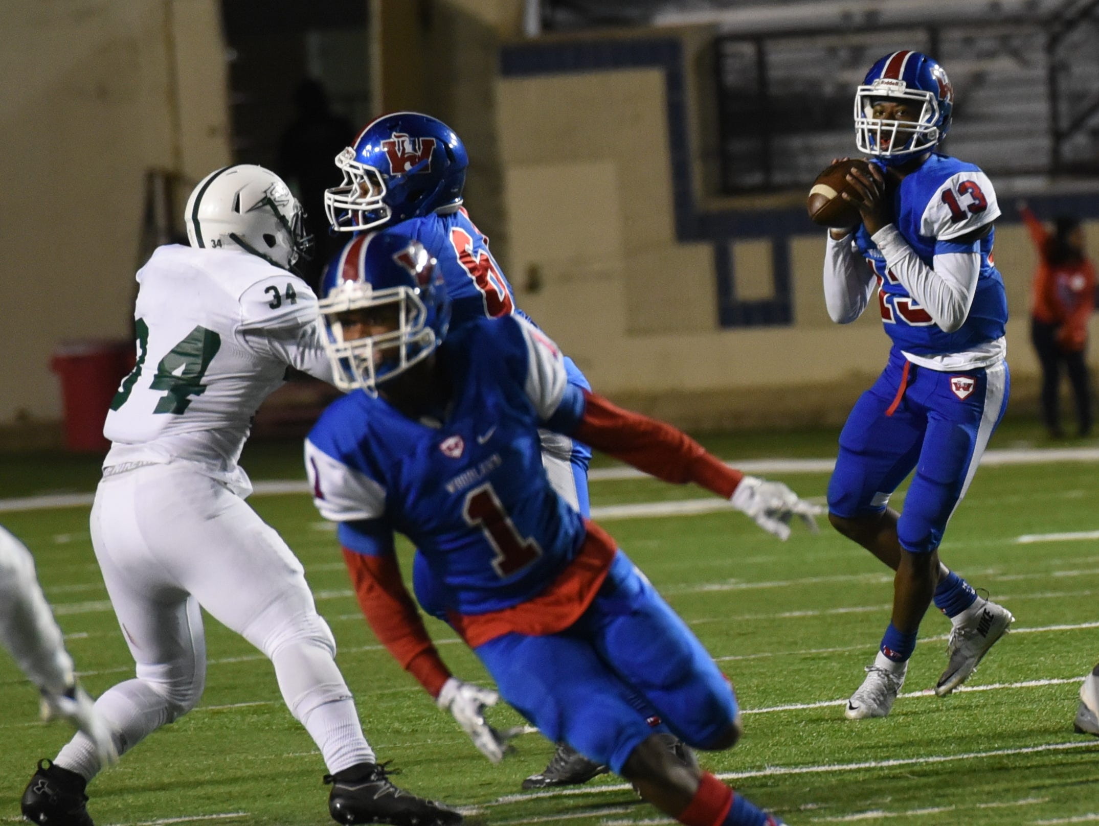 Woodlawn's Joshua Mosley looks for a receiver during their game against Plaquemine Friday evening at Independence Stadium.