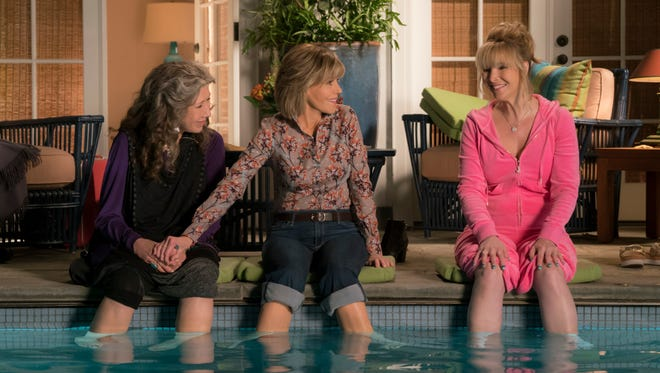 Lisa Kudrow, right, joins Frankie (Lily Tomlin) and Grace (Jane Fonda) to drown her sorrows in the pool.