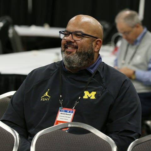 Michigan athletic director Warde Manuel listens...