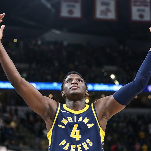Indiana Pacers guard Victor Oladipo (4) holds his...