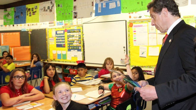 """Gov. Andrew Cuomo speaks with fifth-graders at Hillcrest Elementary School in Peekskill in June. Cuomo on Monday vetoed his own """"safety net"""" bill on teacher evaluations."""