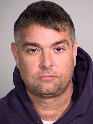 Johnn Scott, a 14-year veteran of the Indianapolis Metropolitan Police Department, was taken into custody around 4 a.m. Wednesday, Aug. 26, 2015.