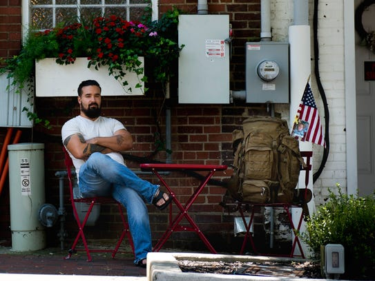 Ernesto Rodriguez, Army vet, poses for a portrait on