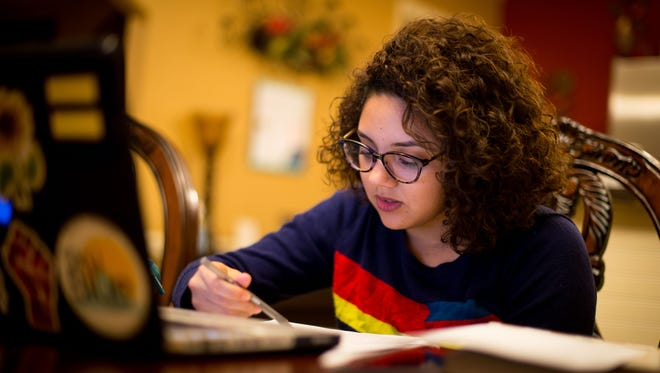 Zacnite Vargas works on her homework at home Nov. 17, 2016, in Nashville. Vargas is a Deferred Action for Childhood Arrivals (DACA) nursing student at Belmont University and is taking general education classes at Trevecca.