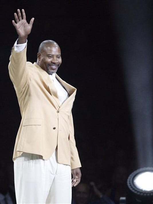 Chris Doleman waves to the crowd after receiving his gold jacket at the Enshrinees' Gold Jacket Dinner at the Memorial Civic Center on Friday, Aug. 3, 2012, in Canton, Ohio. Doleman will be enshrined in the Pro Football Hall of Fame on Saturday.