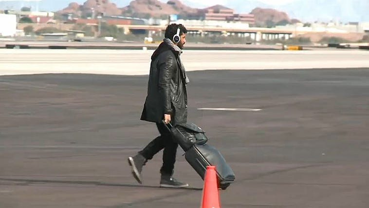 Russell Wilson depart the plane in Arizona.