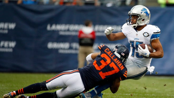Lions receiver Golden Tate is tackled by Chicago Bears cornerback Bryce Callahan on Sunday, Oct. 2, 2016, in Chicago.