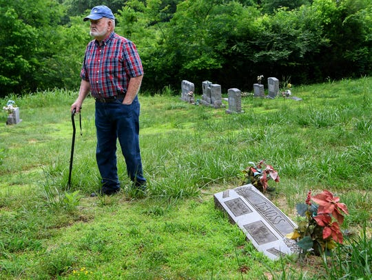 Jim DeMoss walks around the grave of his parents and where he plans on burying his brother at the DeMoss family cemetery in Nashville.