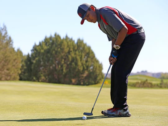 Shiprock sophomore Darnell Chee putts the ball on Monday during the Piedra Vista High School Fall Invite at Pinon Hills Golf Course in Farmington.