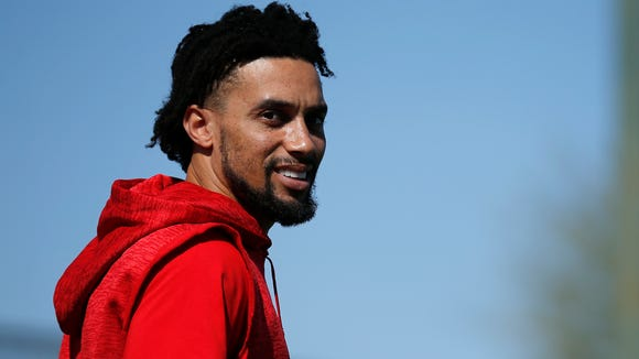 Cincinnati Reds center fielder Billy Hamilton (6) takes the field between hitting workouts during practice at the Cincinnati Reds training complex in Goodyear, Ariz., on Thursday, Feb. 22, 2018.