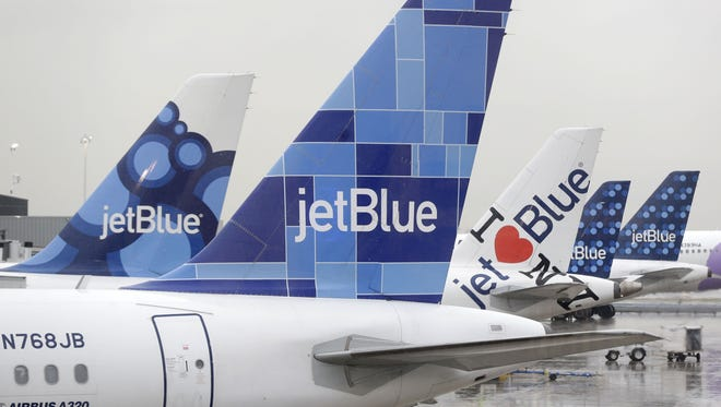 JetBlue airplanes at their gates at John F. Kennedy Airport in New York CIty.