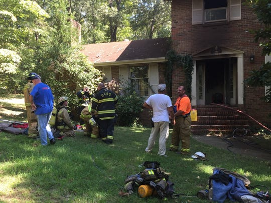 Firefighters outside the White Bluff home in September
