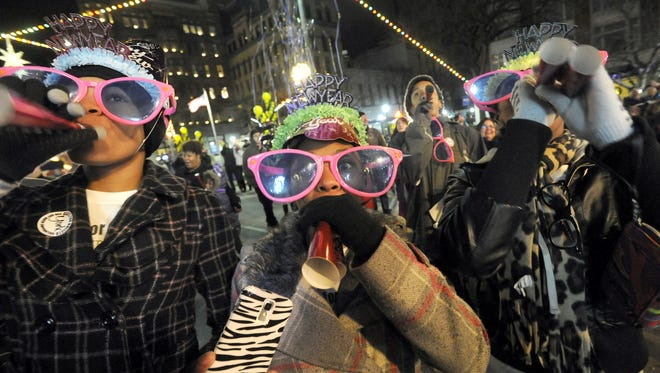 From left: Kristyn Evans, Micah Smith and Kayla Green celebrate the children's countdown at Continental square in downtown York during the New Year's Eve celebration.