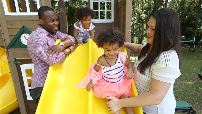 Geordan Joseph his wife Rebeka Joseph and their twin 2-year-old daughters Eva, left, and Leah at the family home on Saturday, May 19, 2018.