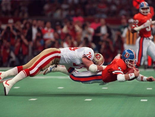 Super Bowl XXIV (49ers 55, Broncos 10): Denver quarterback John Elway dives for extra yardage.